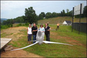 GWWG members: Mary Hallisey Hunt of Georgia Tech's Strategic Energy Inst.; Rick Carson of Tenn. Valley Auth.; Towns County Project Team Leader Teresa Eldredge of TJ Schell LLC and Anna Cayce of Southern Alliance for Clean Energy gathered to view the wind turbine installation at Towns County Schools in Hiawassee